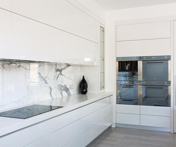 Clean lines, balance and light-filled spaces create a sophisticated and minimalist kitchen with Smeg Linear 60 cm Thermoseal ovens, compact oven, warming drawer and coffee machine. Photography: supplied
