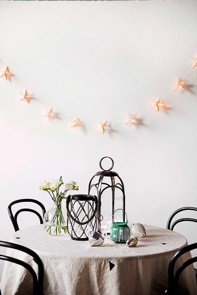 You don't need a big home or table to get into the festive spirit. Star-shaped fairy lights, festive flowers (try poinsettia) and scented candles can create Christmas ambience within a small space. *Photography: Chris Warnes / bauersyndication.com.au*