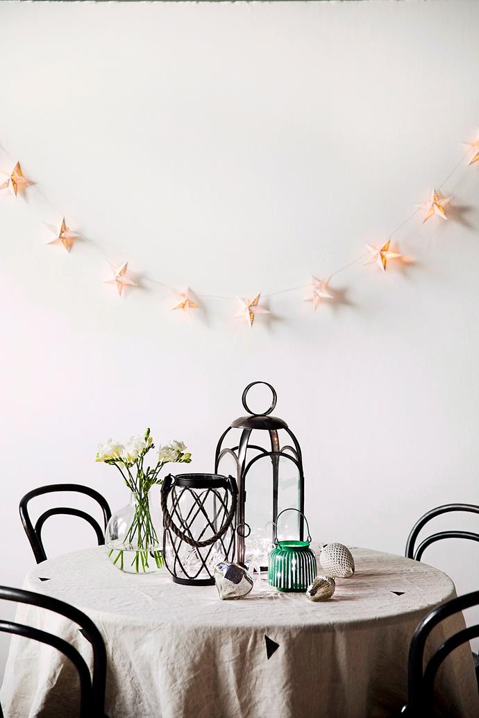 "You don't need a big home or table to get into the festive spirit. Star-shaped fairy lights, [festive flowers](https://www.homestolove.com.au/6-festive-australian-native-plants-12139|target=""_blank"") (try poinsettia) and scented candles can create Christmas ambience within a small space."