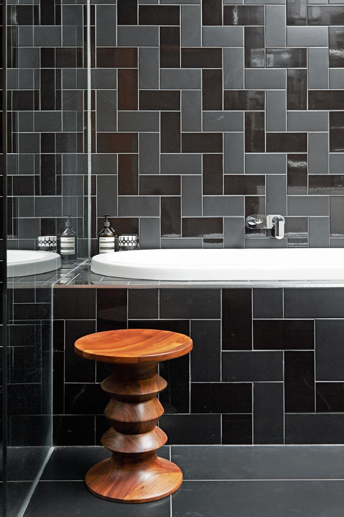 """Black tiles add glamour to the guest bathroom. Stewart used a combination of matt and gloss tiles, laid in a herringbone pattern to create depth and texture. (""""This trick was used on the Sydney Opera House roof,"""" says Stewart)."""