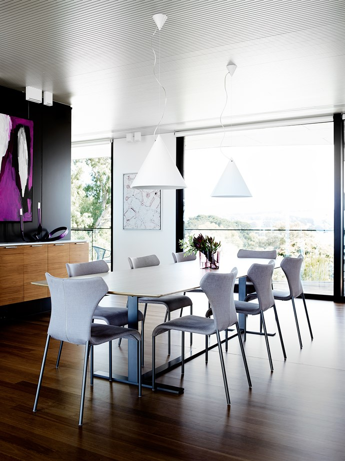 B&B Italia 'Papilio' chairs and 'Eileen' table from [Space](http://www.spacefurniture.com.au/) in the dining area under Flos 'Diabolo' suspension lights.