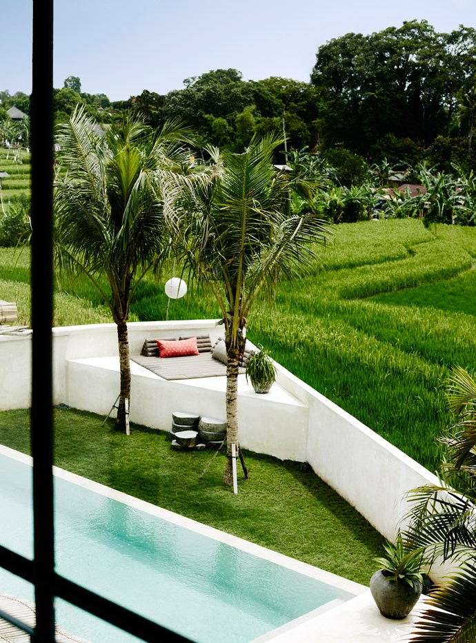 The swimming pool sparkles against the brilliant green of the rice paddies beyond. A triangular-shaped lounging platform is the perfect spot for catching the sunset.