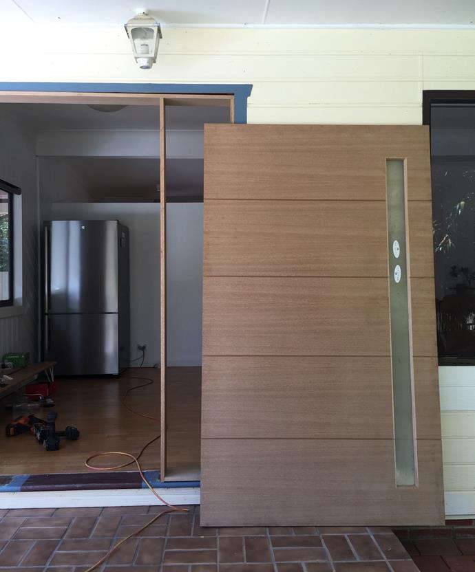 The new merbau timber door, ready to install and be painted. Image credit: Little Red Industries