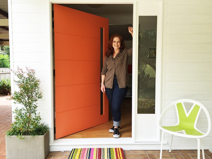 I chose orange to pack a punch and painted the front of the house in tradie white to make it feel clean and fresh. Image credit: Little Red Industries