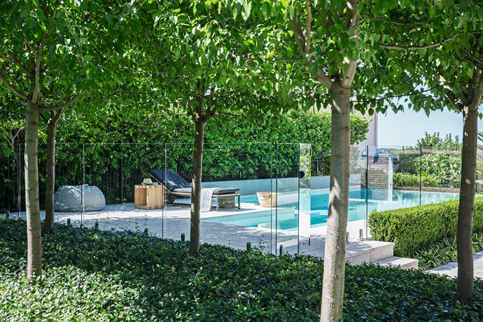 """The pool coping and surrounds are tiled in travertine, while the pool is lined with white glass mosaics. """"White is the best way to achieve natural water tones,"""" says Matt. """"It's like replicating white sand at the beach."""""""