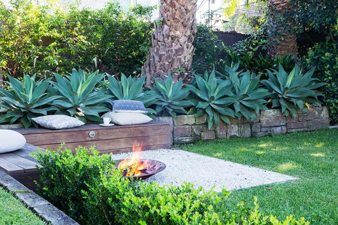 A fire pit is a great way to get more use out of your garden. It doesn't have to be built-in – a steel bowl can be effective.