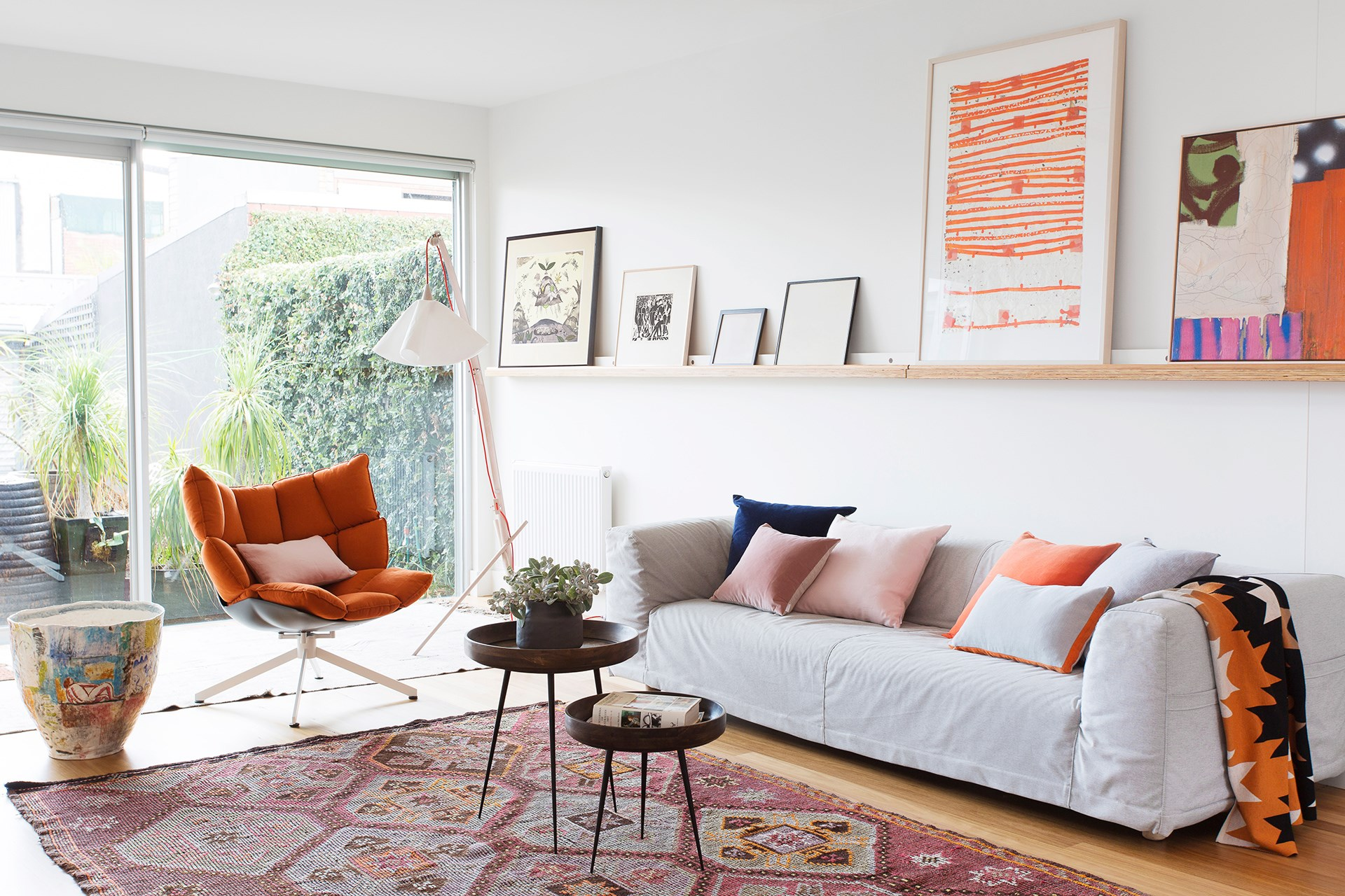 This light-filled living room is brought to life with bursts of burnt orange and terracotta, contrasted perfectly with soft pink and grey for a vibrant yet sophisticated style. [> See the rest of this bespoke Melbourne terrace here.](http://www.homestolove.com.au/bespoke-renovation-of-an-old-victorian-terrace-4456) Photo: Martina Gemmola / Australian House & Garden