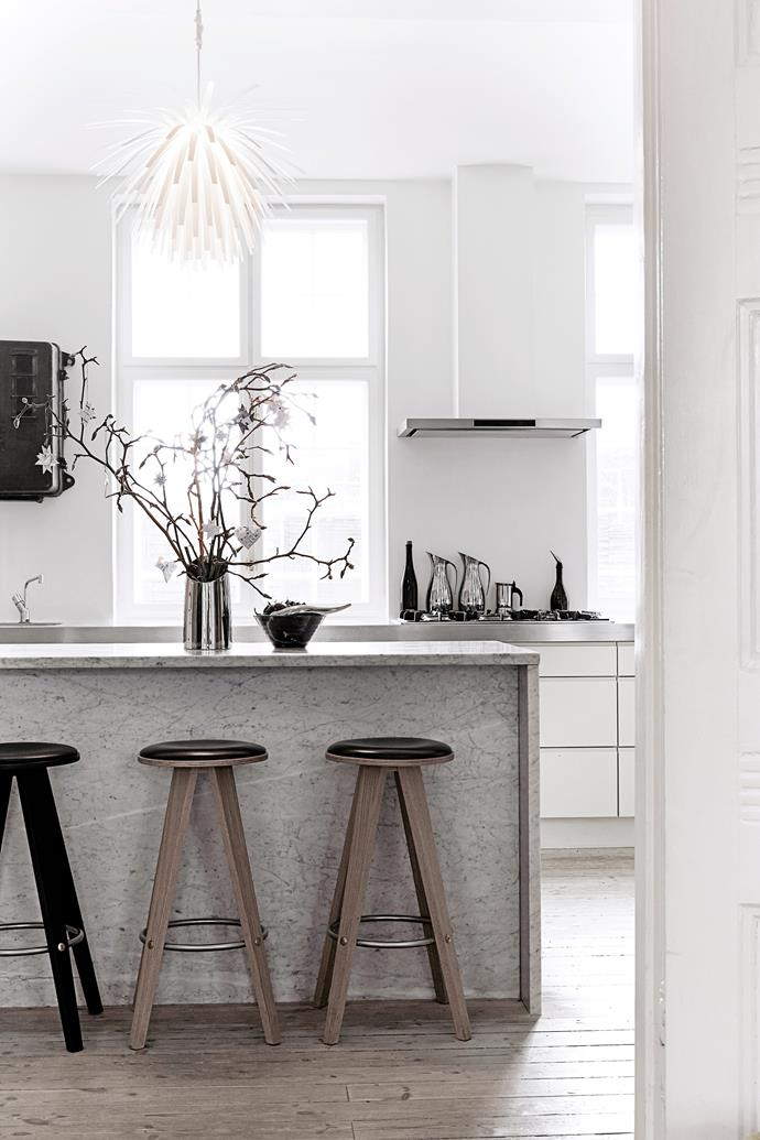 "The couple designed the kitchen's [marble benchtop](http://www.homestolove.com.au/how-to-care-for-marble-benchtops-3745|target=""_blank""). A magnolia branch from the garden is also decorated with homemade paper stars. So easy, so beautiful."