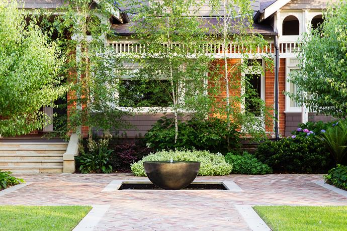 A simple, elegant water bowl provides a strong accent point at the entrance.