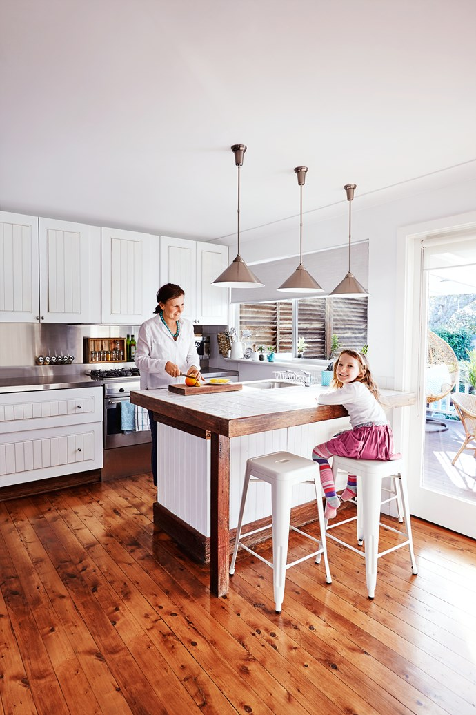 """I love that the new kitchen is light and airy; it's also more functional. The old L-shaped kitchen was dark and pokey, with the sink located under the window."""