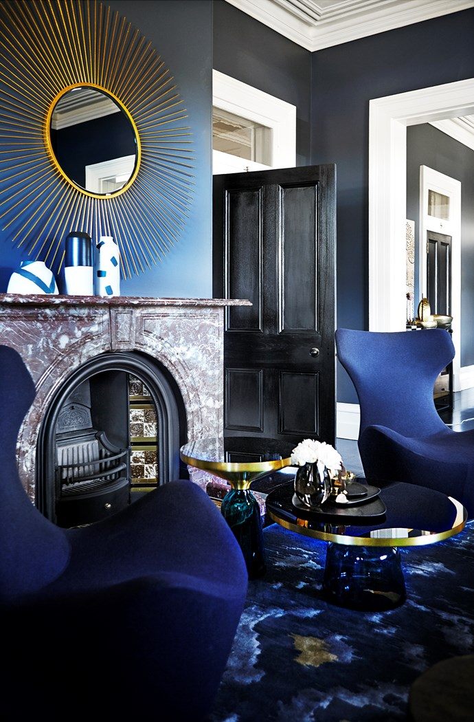 """Moody blues and metallic hints reign in the living room. B&B Italia 'Grand Papilio' chairs from [Space](http://www.spacefurniture.com.au/