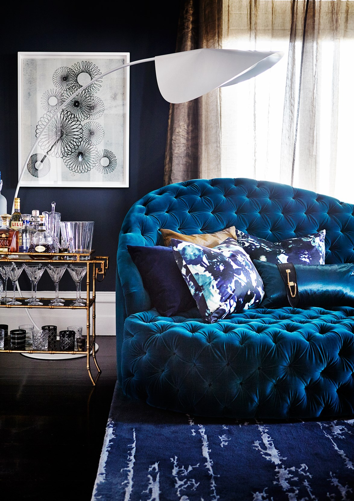 """This blue velvet beauty was custom designed for the living room of this [restored heritage home in Brisbane](https://www.homestolove.com.au/bold-restoration-of-a-heritage-brisbane-landmark-4493