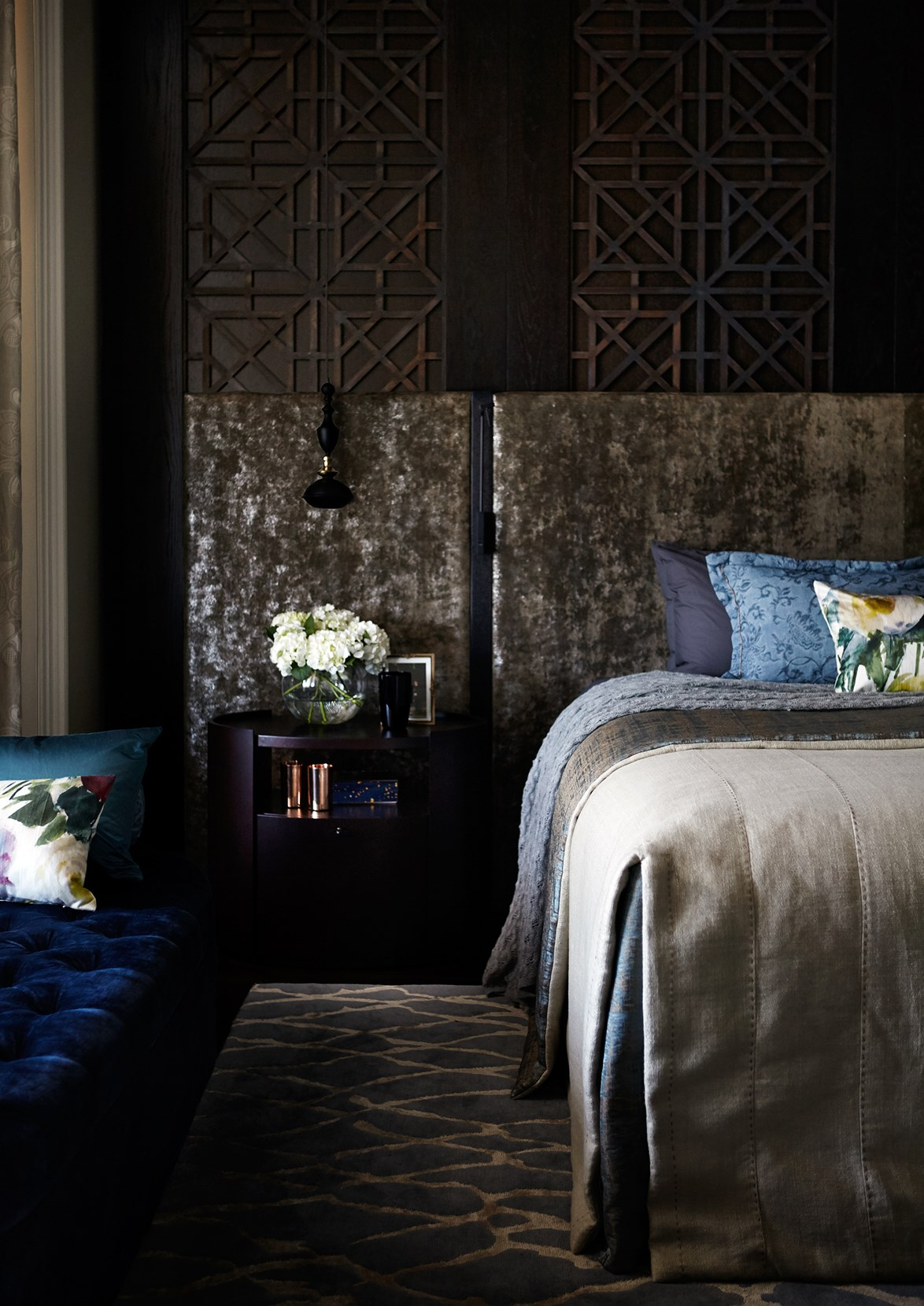 "Every inch of [this bedroom](https://www.homestolove.com.au/bold-restoration-of-a-heritage-brisbane-landmark-4493|target=""_blank"") is cosy and inviting, from the warm taupe canvas to pops of moody velvet blue. Layering textures is [an easy way to prepare your home for winter](https://www.homestolove.com.au/10-easy-ways-to-prepare-your-home-for-winter-4892