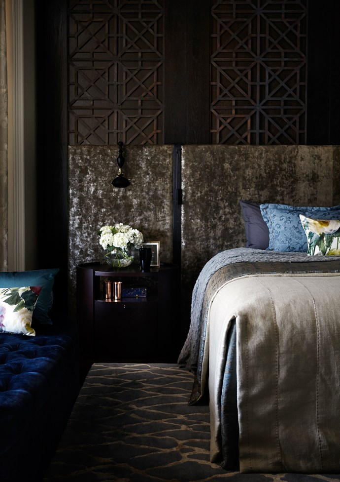 """Custom-designed bedhead, side table and ottoman by Louise Walsh. Screens by [Artifex Interiors](http://artifex.com.au/