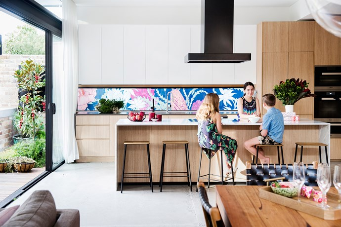 """The renovation was designed by [architect Vanessa Wegner](http://www.vanessawegnerarchitect.com/) to cater for the growing needs of Remi, 11, Pirra, 14, and Carter, nine. The statement splashback is a mural by [botanical illustrator Adriana Picker](http://www.adrianapicker.com/ target=""""_blank"""" rel=""""nofollow""""), painted on a sheet of fibre cement and protected by a pane of glass."""