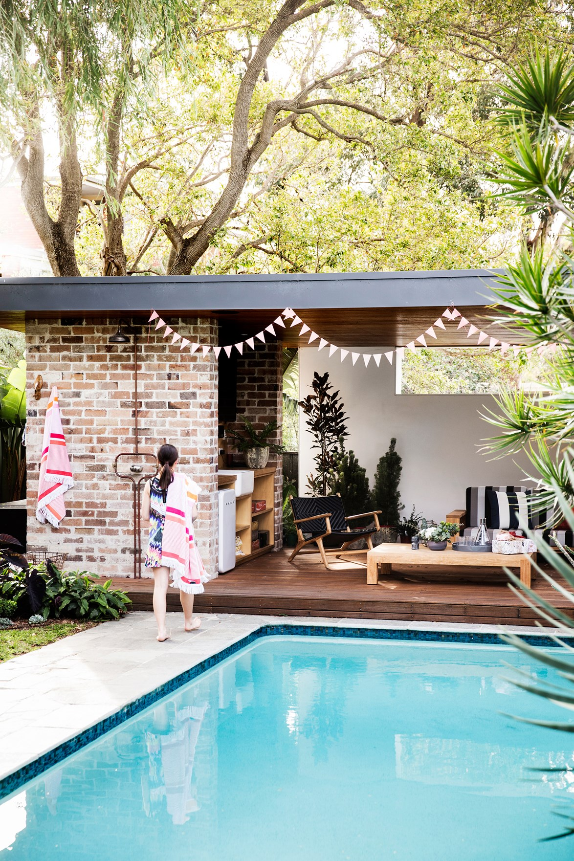 "**Create an outdoor relaxation room**<br> An [outdoor room](https://www.homestolove.com.au/inviting-outdoor-room-ideas-19144|target=""_blank"") set away from the house can give occupants their own space when they need it, and a simple pergola or poolside cabana helps define the space. From the [outdoor shower](https://www.homestolove.com.au/outdoor-shower-ideas-19532