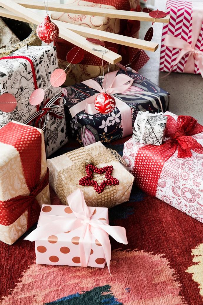 """A little bit of Christmas trim goes a long way. Gift wrap, *Australian House & Garden*, [Bespoke Letterpress](http://www.bespokepress.com.au/ target=""""_blank"""" rel=""""nofollow"""") and [Vandoros Fine Packaging](http://www.vandoros.com.au/ target=""""_blank"""" rel=""""nofollow""""). Ribbon from [Koch & Co](https://www.koch.com.au/ target=""""_blank"""" rel=""""nofollow""""), [Stampin' Up!](http://www.stampinup.com/home/en-AU/catalogues_au target=""""_blank"""" rel=""""nofollow"""") and [Vandoros Fine Packaging](http://www.vandoros.com.au/ target=""""_blank"""" rel=""""nofollow"""")."""
