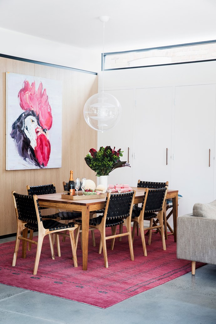 """""""We did the decorating ourselves,"""" says Jodie. """"The last piece in the puzzle was the fabulous Verner Panton Globe light over the dining table, which was sourced for us by [Vampt Vintage Design](http://vamptvintagedesign.com/ target=""""_blank"""" rel=""""nofollow"""")."""""""