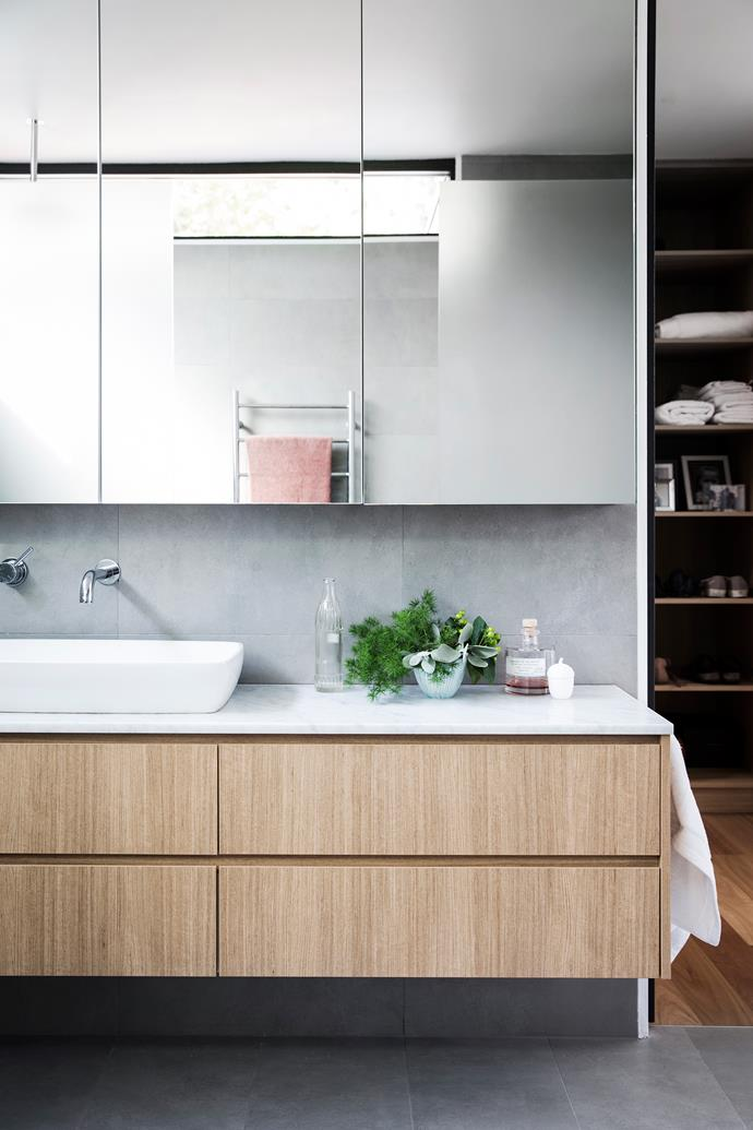 The soothing main ensuite is a showcase for the mixed materials palette.