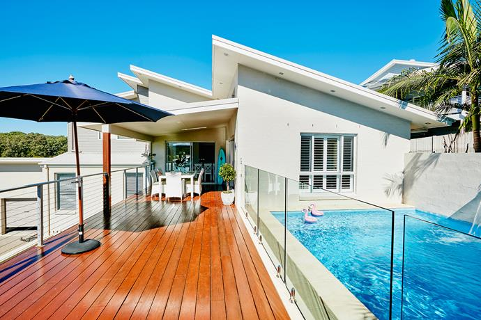 """""""When we're at home I can open up the shutters and watch the children in the yard. In summer we all love getting outside and cooling off in the beautiful pool – it adds a resort-style quality to our home. This is serene seaside living at its best,"""" says Sharna."""