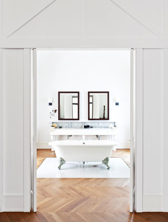 "The bathtub is rightfully front and centre in [Fiona Sinclair's elegant, symmetrical bathroom](https://www.homestolove.com.au/interior-style-q-and-a-fiona-sinclair-of-fred-bare-1800|target=""_blank"") and home."