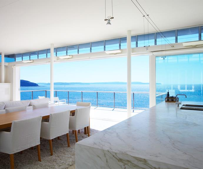 The open-plan kitchen and dining zone with a marble benchtop that looks almost as good as the view! Photo: [Unique Estates](http://uniqueestates.com.au/listings/holiday_rental-298732-palm-beach/).