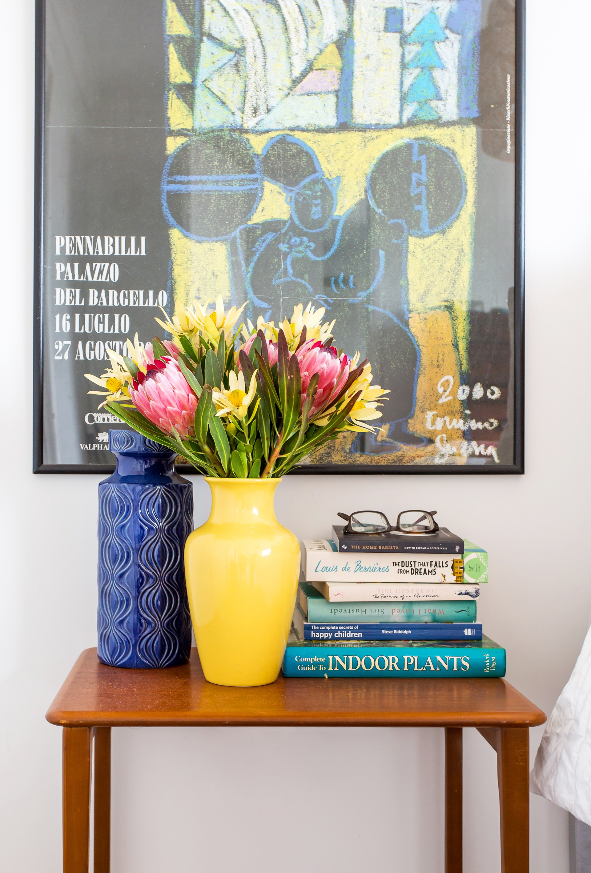 Vintage prints, op shop finds and classic colourful vases complete this retro vignette. Photo: Katherine Jamison / homes+