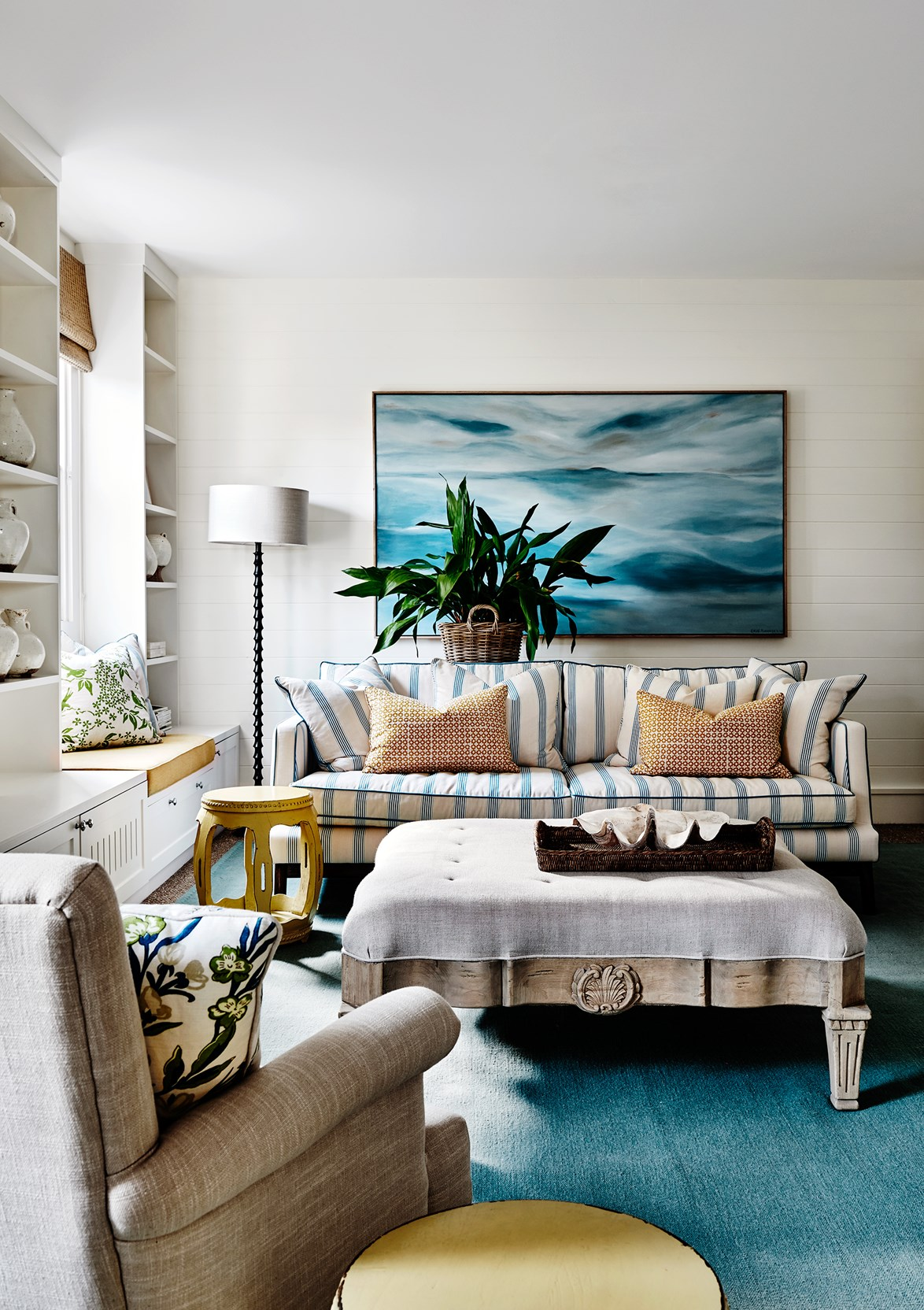 """Nothing says Hamptons style quite like blue and white pinstripes! This statement sofa in a [hamptons style weekender](https://www.homestolove.com.au/hamptons-style-mornington-peninsula-weekender-4558
