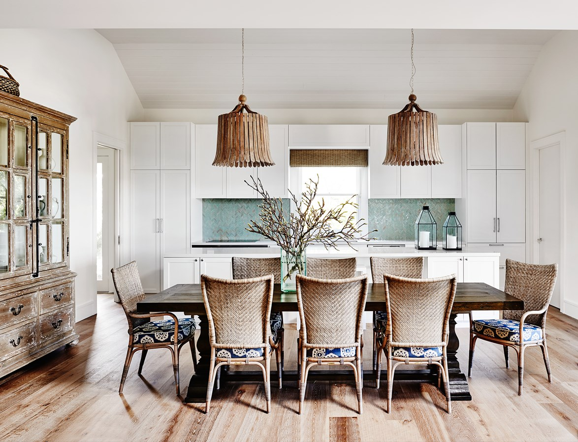 Injections of turquoise, geometric tiles and lashings of timber give this Hamptons kitchen a contemporary coastal look. Photo: Lisa Cohen / *Belle*