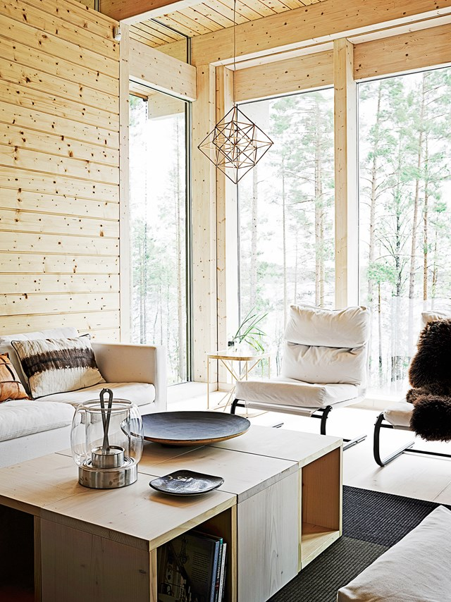 "It doesn't get much more Scandinavian than this [timber cabin](https://www.homestolove.com.au/a-scandinavian-inspired-timber-cabin-4561|target=""_blank"") in the woods, filled with Finnish and Danish designs, white furnishings and rugged textures which make for a beautifully serene escape. *Photo:* Krista Keltanen"
