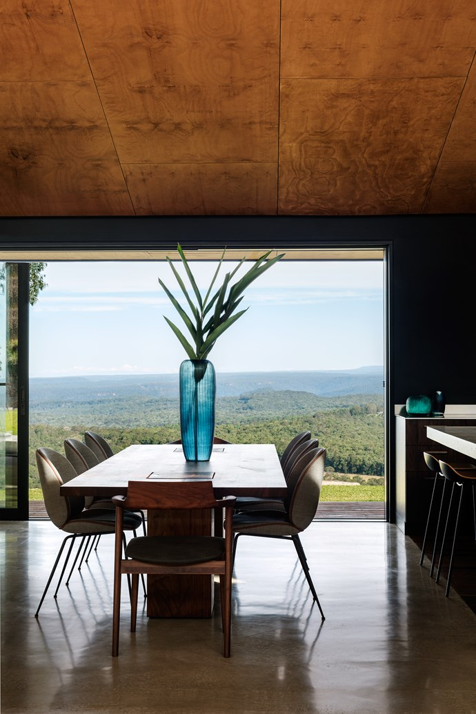 A strategically placed 'Boss' executive dining table from Fanuli with Gubi upholstered chairs from Cult, takes full advantage of the breathtaking view.