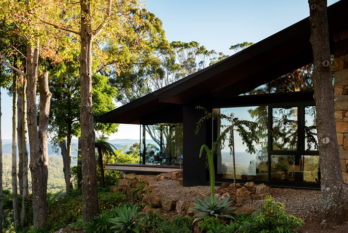 Located high on a terrace overlooking rainforest, the pod-style home is set in a garden of exotics planted to enjoy the season's changing colours.