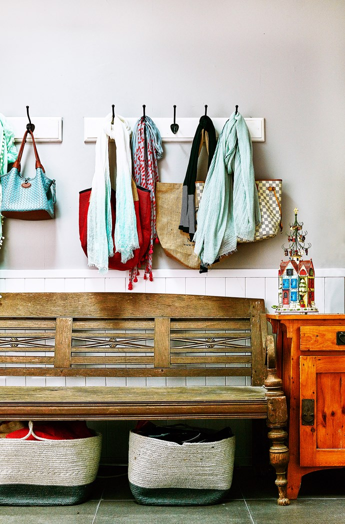 Cute wall hooks offer practical and attractive storage. Woven storage baskets underneath bench are from Kmart.