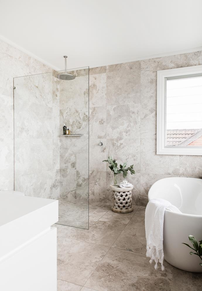 Hardwearing limestone is used in both bathrooms. Large-format tiles mean less scrubbing. Tundra Grey limestone wall and floor tiles, [Marble & Ceramic Corp](https://www.marbleceramiccorp.com.au/). Bath, showerhead and tapware, all [Reece](http://www.reece.com.au/). Towel, [Sheridan](https://www.sheridan.com.au/).