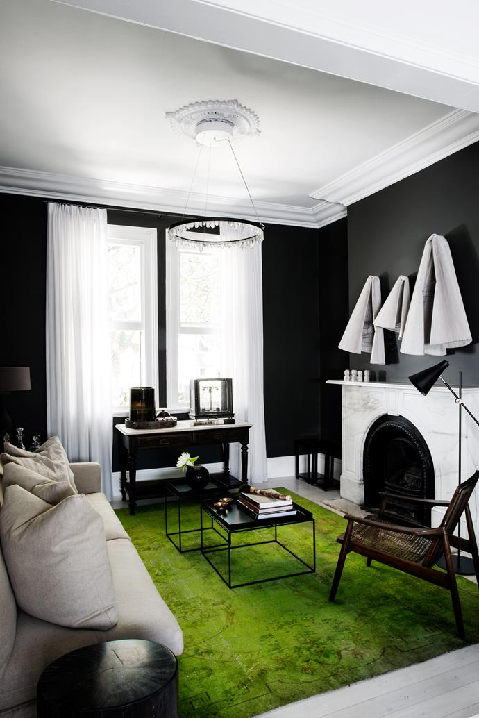 """""""I wanted the front sitting room to be more cosy, so we painted it a dark colour,"""" says Maria."""