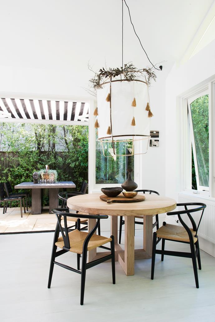 """""""I love looking through the house and seeing the white framing the green outside,"""" says Maria."""