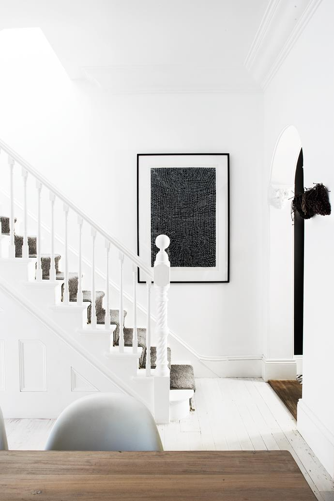 Artwork by Dorothy Napangardi. Wire and rope artwork on wall facing the stair is Night Owl by Tracey Deep.