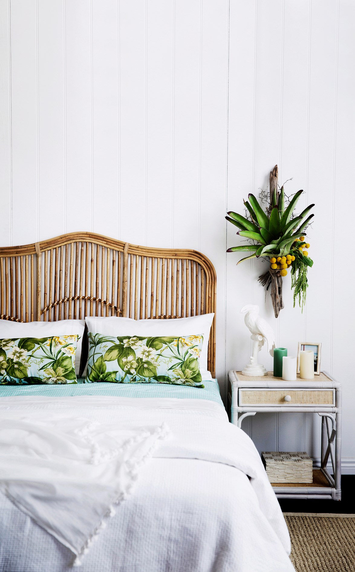 A cane or rattan bedhead can transform even the simplest bedroom into an inviting summer retreat.