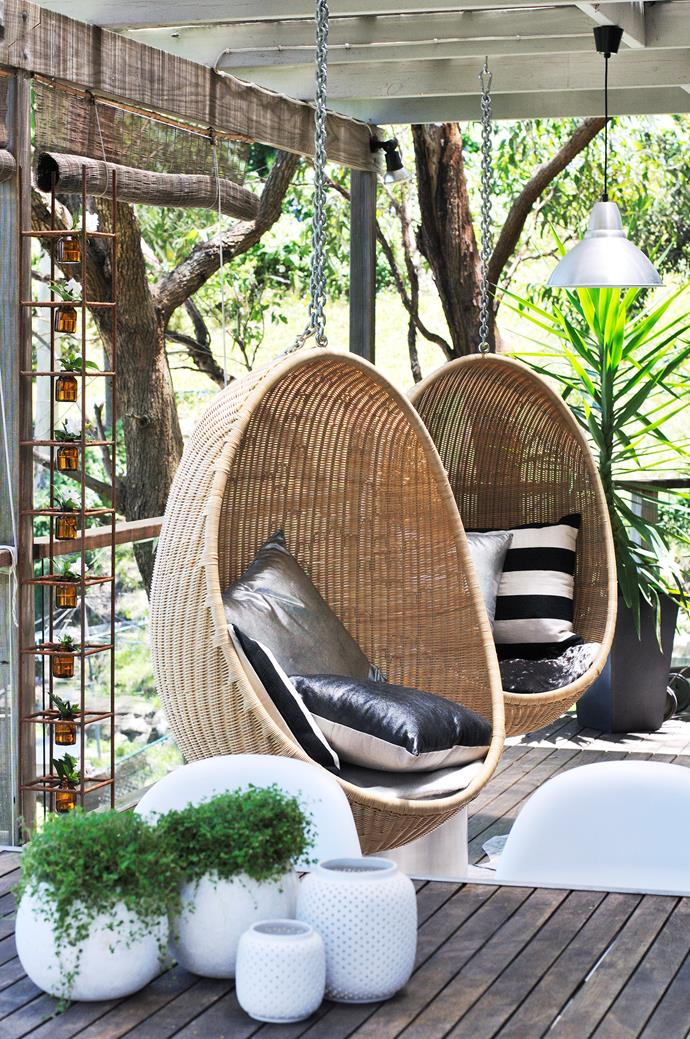 **Outdoor -** Cane and wicker outdoor furniture like this hanging egg chair has a resort feel, creating relaxed elegance that invites people outside. Photo: Robert Reichenfeld / bauersyndication.com.au