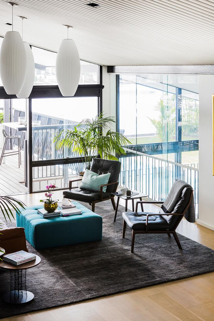 With floor-to-ceiling windows on the north face, the living room is lovely and light year-round.