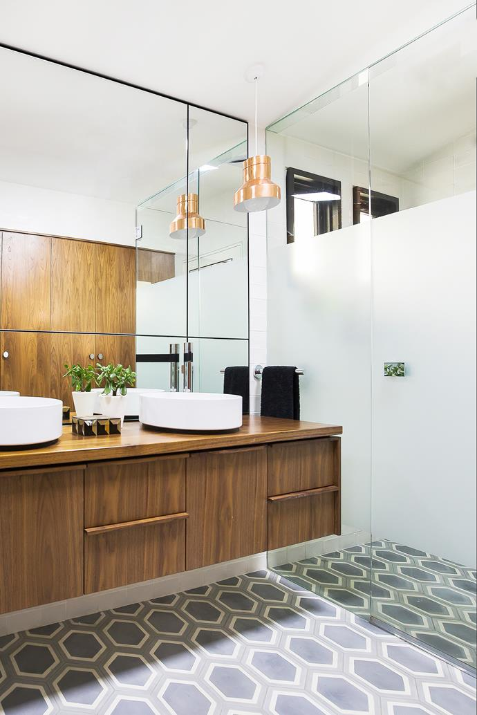 A walk-in shower is a luxurious addition. American-walnut joinery ties in with that elsewhere in the house.