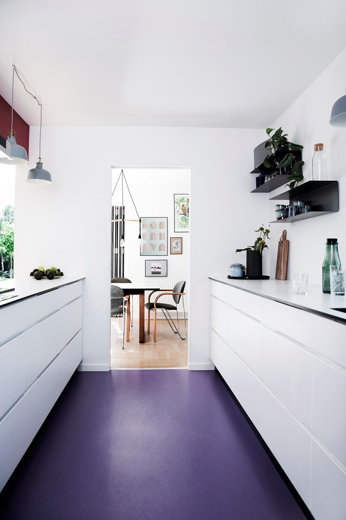 "In this [revamped Modernist home](http://www.homestolove.com.au/gallery-living-colour-3221|target=""_blank"") plum-coloured vinyl flooring gives the contemporary white kitchen some unexpected drama. *Photo: Tia Borgsmidt*"