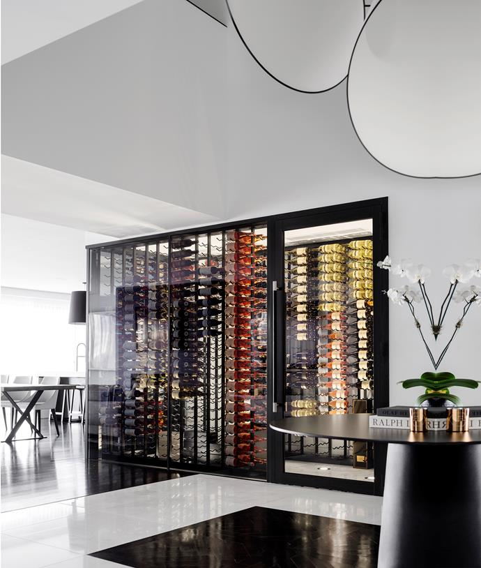 Custom wine rack is a feature in the large living area.