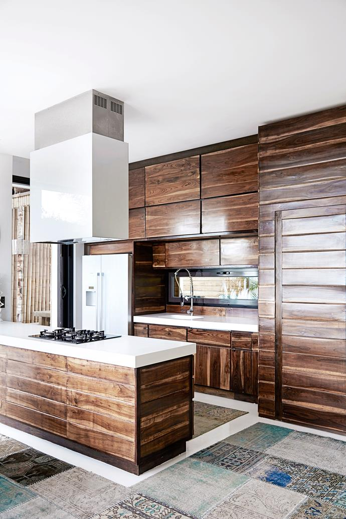 Timber from Bali and Corian benchtops provide a fabulous contrast in the open-plan kitchen.