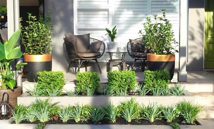 New furniture and more shrubs enhance the entrance and offer another spot to sit.