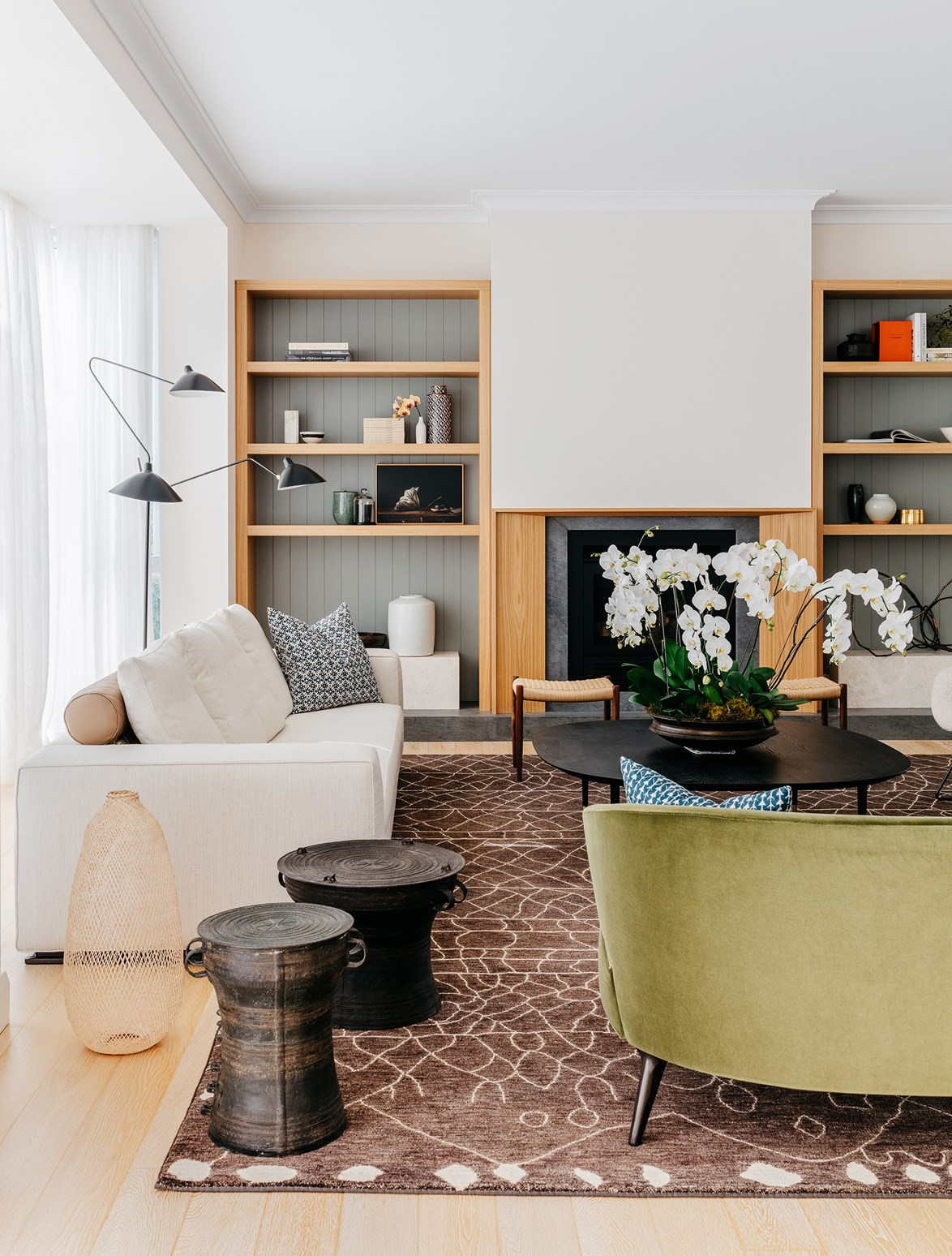 """<p>**AS A SHELVING ACCENT**<p> <p>Not prepared to panel an entire wall? Start with small steps, like panelling the back of a shelf to create an extra layer of interest to beautifully styled vignettes. Take style cues from this living room in a [contemporary home](https://www.homestolove.com.au/how-to-infuse-warmth-into-a-contemporary-home-4628