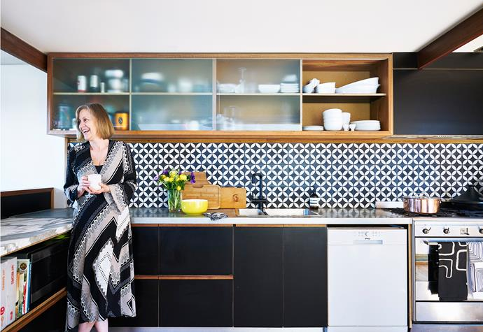 Mel in the kitchen, which Terry built from recycled materials. The benchtops are made from folded zinc (rear)  and a Calacatta marble offcut. Blanco sink and Smeg oven, from [Winning Appliances](http://www.winningappliances.com.au/).