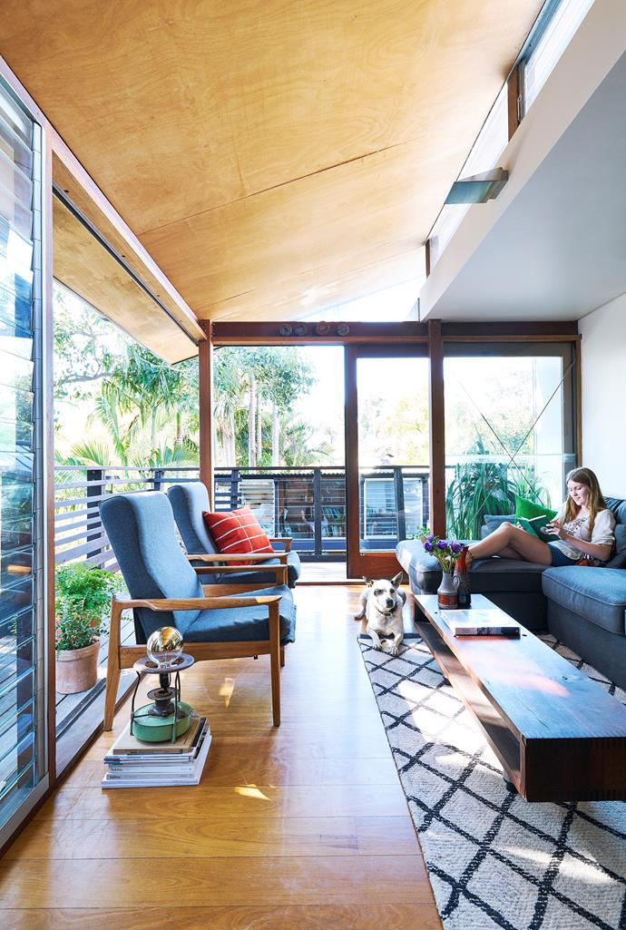 Along with recycled materials, Terry borrowed heavily from the surrounding landscape to bring sunlight, fresh air and views into the house. The main living area is at treetop height and has glass doors on two sides that open to a wraparound deck.