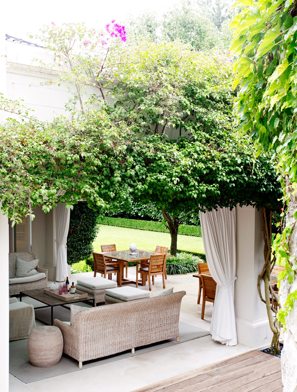 """Beneath a leafy pergola is a [sublime outdoor entertaining space](https://www.homestolove.com.au/20-sublime-spots-for-entertaining-4638