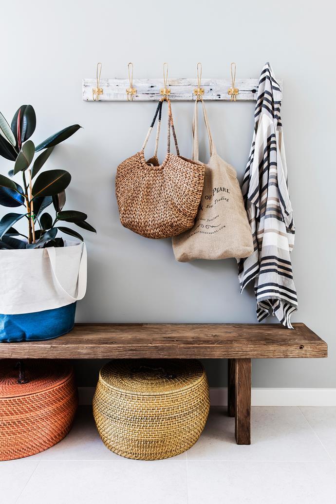 A beautifully composed tableau of natural textures. Hanging rack, [MRD Home](https://mrdhome.com.au/). Bench, [Bisque Interiors](https://bisqueinteriors.com.au/).